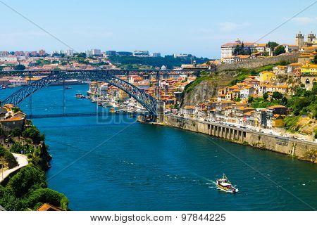 Porto old town skyline on the Douro River with famous landmark Luis bridge