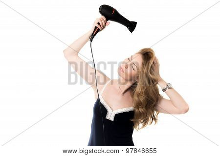 Female Model Drying Her Hair With Hairdryer