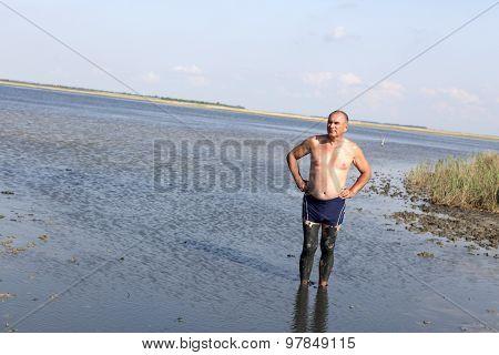 Senior Man Using Healthy Mud