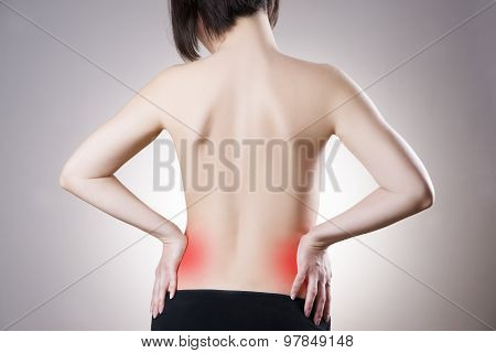 Woman With Backache. Pain In The Human Body