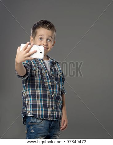 Little Boy Doing Photo Of Him Self Over
