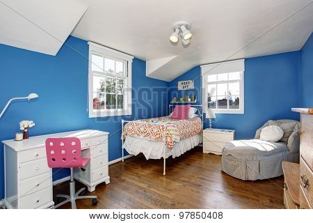 Adorable Girls Room With Deep Blue Walls.