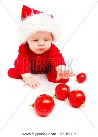 Baby Playing With Christmas Decoration
