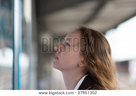 Young Woman Checking A Timetable