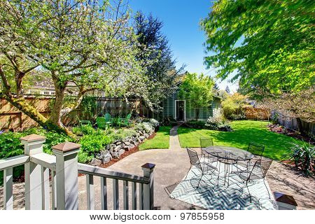 Large Furnished Patio With Trees.