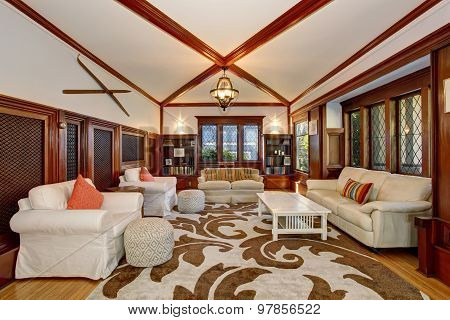 Authenic Living Room With Brown And White Decorative Rug.