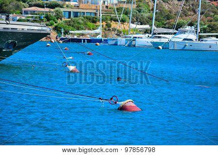 Boat Ropes And Hulls In Porto Cervo