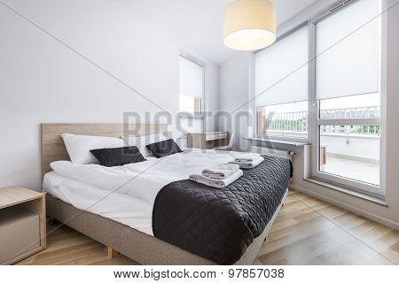 Bedroom With Empty Wall In Scandinavian Style