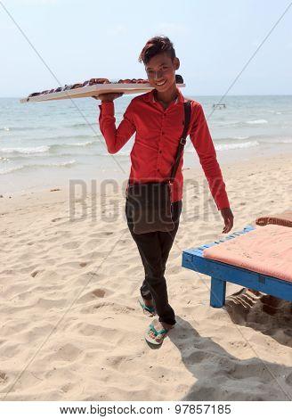Beach Seller Boy Of Sunglasses On Coastline