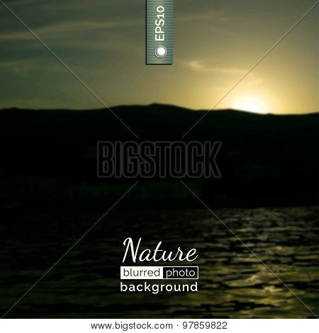 Blurred photo background with sunset.