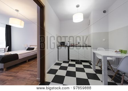 White And Black Small And Compact Kitchen End Bedroom