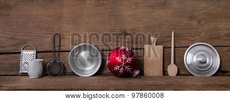 Old kitchen miniatures on wooden background for christmas decoration.