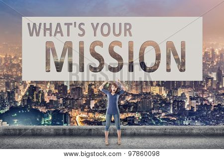 What's your mission, words on blank board hold by a young girl in the outdoor.
