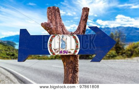 Virginia Flag wooden sign with highway on background