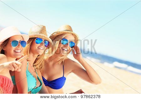 A picture of a group of friends sunbathing on the beach