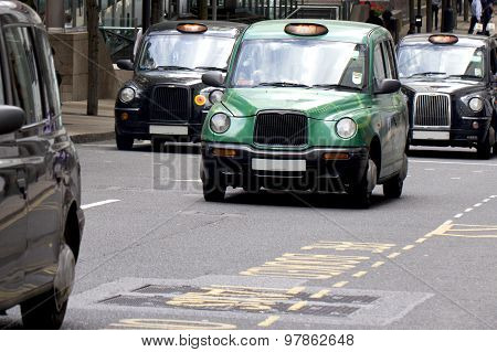 Four London Taxi Cabs