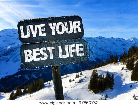 Live Your Best Life sign with winter landscape on background