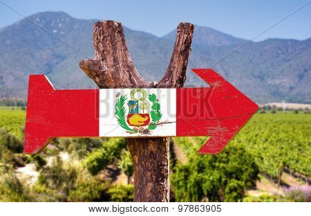 Peru Flag wooden sign with winery background
