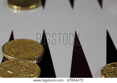 Coins On A Backgammon Board