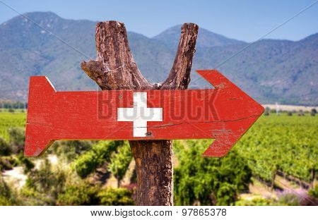 Switzerland Flag wooden sign with winery background