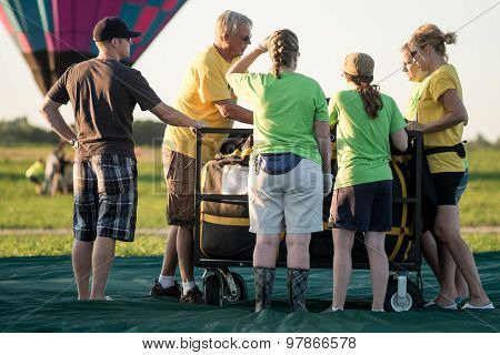 Hot air balloon crew members planning on unpacking their kit