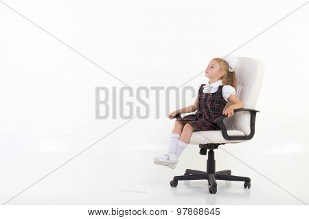 Girl Proudly Sits On A Chair