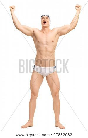 Full length portrait of an overjoyed male swimmer in white swim trunks celebrating victory isolated on white background