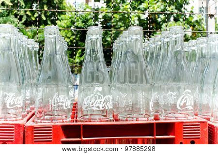 Empty bottles of Coca Cola for recycle