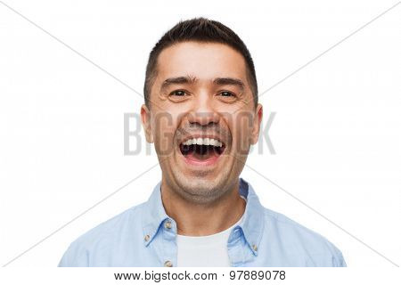 happiness, emotions and people concept - laughing man