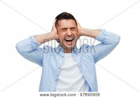 stress, headache, health care and people concept - unhappy man with closed eyes touching his forehead