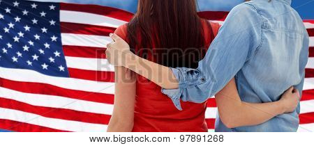 people, homosexuality, same-sex marriage, gay and love concept - close up of happy women couple hugging over american flag background