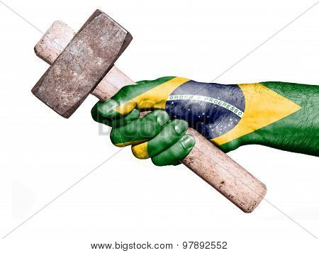 Hand With Flag Of Brazil Handling A Heavy Hammer