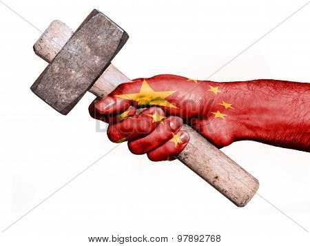 Hand With Flag Of China Handling A Heavy Hammer