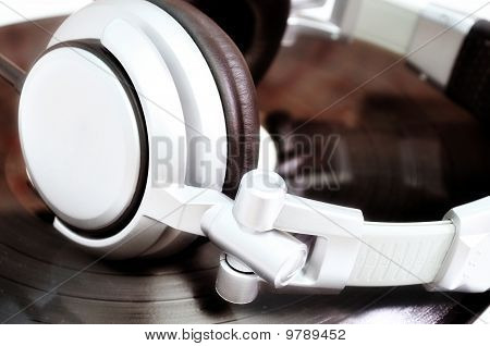 Dj Headphones Lying Over Old Vinyl