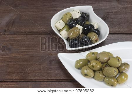 Dishes With Olives On The Wooden Desk