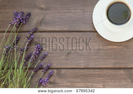 Lavender And Cup Of Coffee On The Wooden Desk