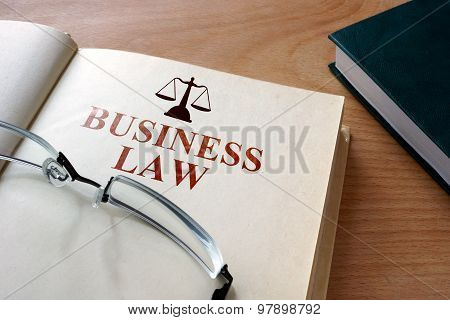 Notepad with words  business law.