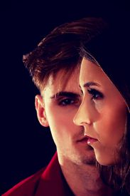 picture of male-domination  - Dominating man is serious looking on a woman - JPG