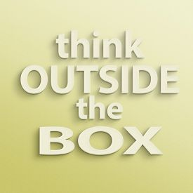 picture of thinking outside box  - text on the wall or paper - JPG