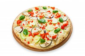 picture of crust  - Delicious italian vegetarian pizza with cherry tomatoes peppers aubergines and zucchini  - JPG