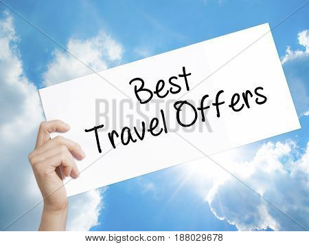 Best Travel Offers  Sign On White Paper. Man Hand Holding Paper With Text. Isolated On Sky Backgroun