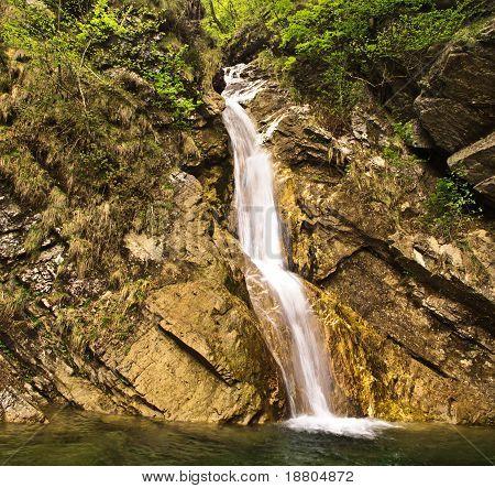 Waterfall of stream over steep rockfall
