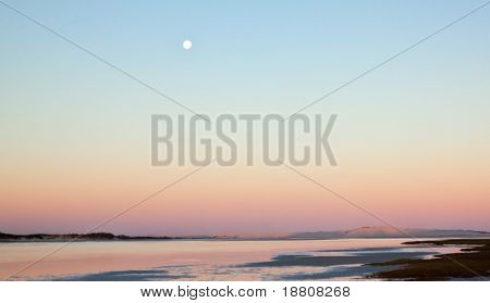 Moonrise over a lagoon with a lovely color shades