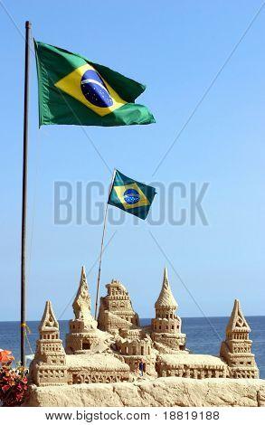 Brazilian flag on Copacabana beach in Rio de Janeiro