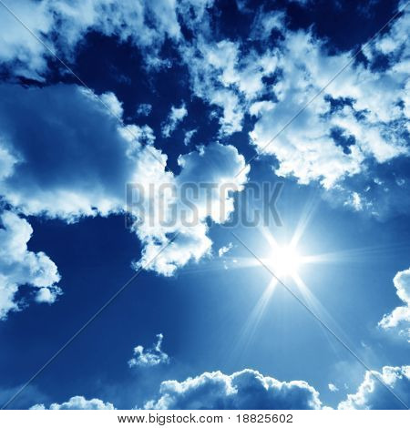 Beautiful sky with bright sun and fluffy clouds