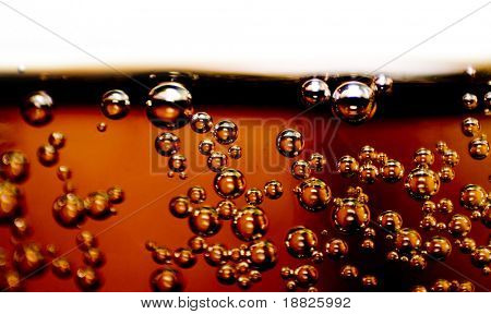 Closeup of soft drink with bubbles in glass