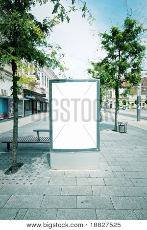 Blank advertising panel in city