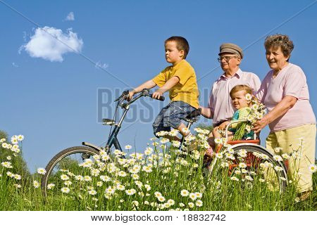 Ride with grandparents among daisies