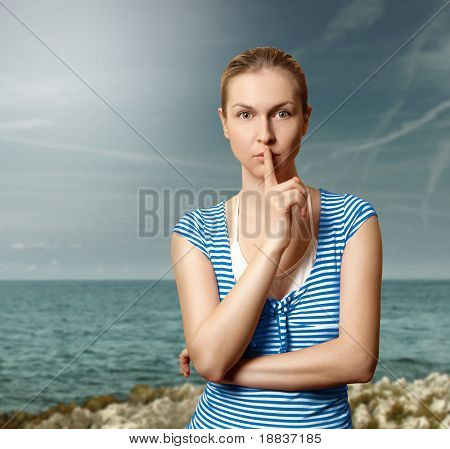 Sporty women with finger near mouth