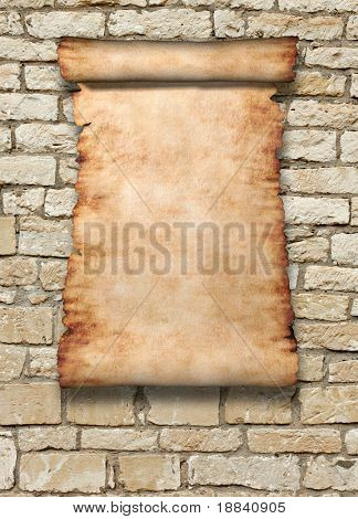 Vintage roll of parchment on ancient stone wall vertical background